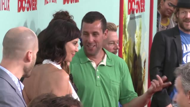 Adam Sandler and David Spade attend the premiere of Netflixs THE DO OVER in Los Angeles