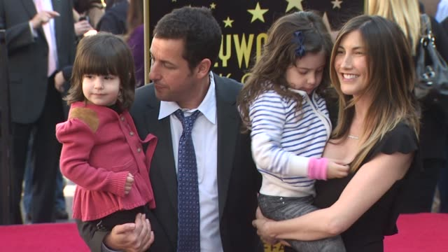 adam sandler and family at the adam sandler honored with a star on the hollywood walk of fame at hollywood ca. - アダム・サンドラー点の映像素材/bロール