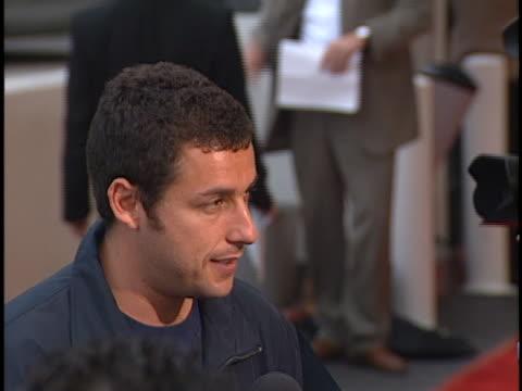adam sandler at the big daddy premiere at avco theater, westwood in westwood, ca. - アダム・サンドラー点の映像素材/bロール