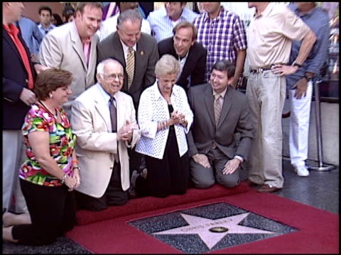 Adam Sandler at the Dediction of Chris Farley's Walk of Fame Star at the Hollywood Walk of Fame in Hollywood California on August 26 2005