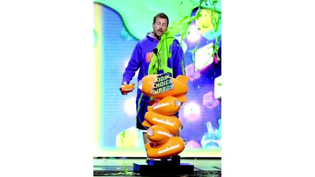 adam sandler gets slimed with the favorite male voice from an animated movie award for ' hotel transylvania 3: summer vacation' onstage at... - nickelodeon stock videos & royalty-free footage