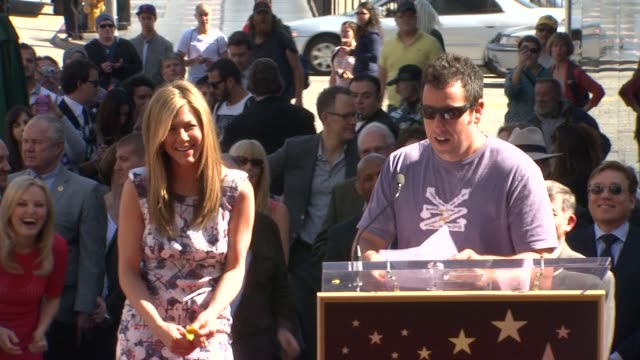 adam sandler on jennifer aniston at jennifer aniston honored with star on the hollywood walk of fame in hollywood ca on 2/22/12 - adam sandler stock videos & royalty-free footage