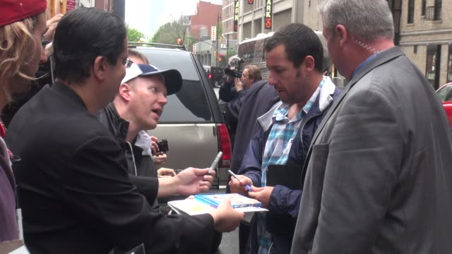 adam sandler signs for fans outside the late show with david letterman in celebrity sightings in new york - adam sandler stock videos & royalty-free footage