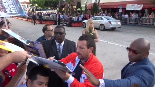 adam sandler signs for fans outside the premiere of netflix's murder mystery outside regency village theatre in westwood in celebrity sightings in... - adam sandler stock videos & royalty-free footage