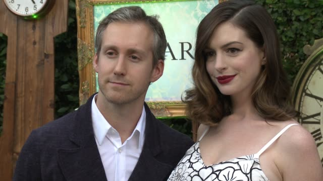 Adam Shulman and Anne Hathaway at 'Alice Through The Looking Glass' Event At Roseark at Roseark Gallery on May 12 2016 in Los Angeles California