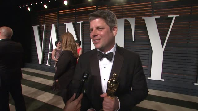 interview adam stockhausen at the 2015 vanity fair oscar party hosted by graydon carter at wallis annenberg center for the performing arts on... - wallis annenberg center for the performing arts stock videos and b-roll footage