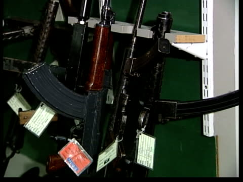 adams announcement on possible ira disarmament itn lib seq seized terrorist weapons on display in room - disarmament stock videos and b-roll footage
