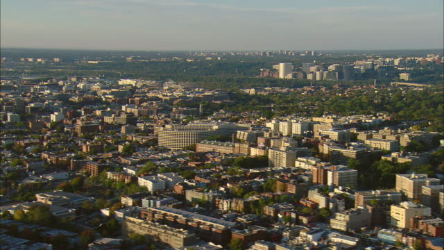 aerial adams morgan area with georgetown and office buildings of rosslyn in distance, washington d.c., usa - arlington virginia video stock e b–roll
