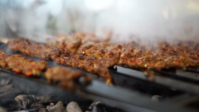 adana kebab on grill - skewer stock videos & royalty-free footage