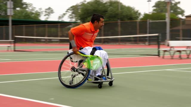 stockvideo's en b-roll-footage met ms ts adaptive athlete chasing down shot during wheelchair tennis match - tennis