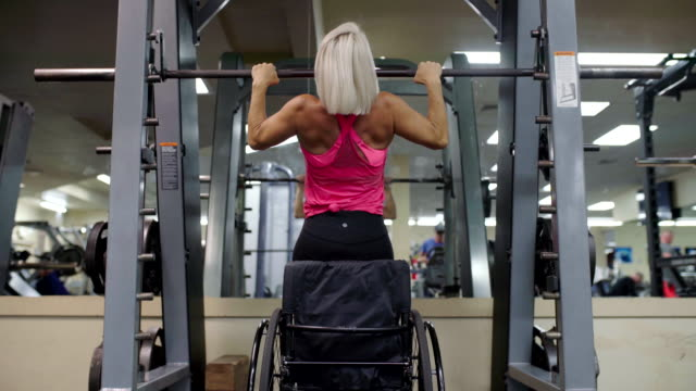 adaptive athlete in a wheelchair doing pull ups - muscular build stock videos & royalty-free footage