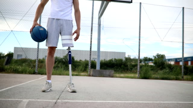 adaptive athlete on a basketball court - conquering adversity stock videos & royalty-free footage