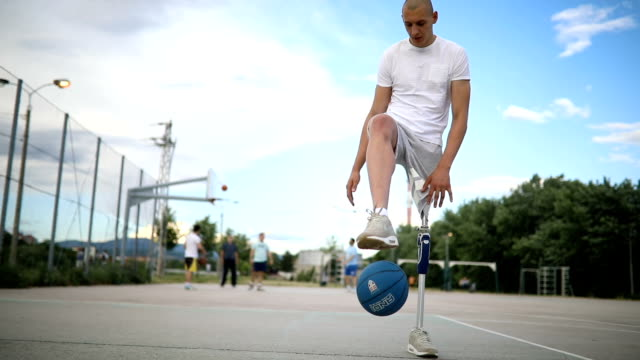 adaptive athlete recovering on a basketball court - adaptive athlete stock videos and b-roll footage