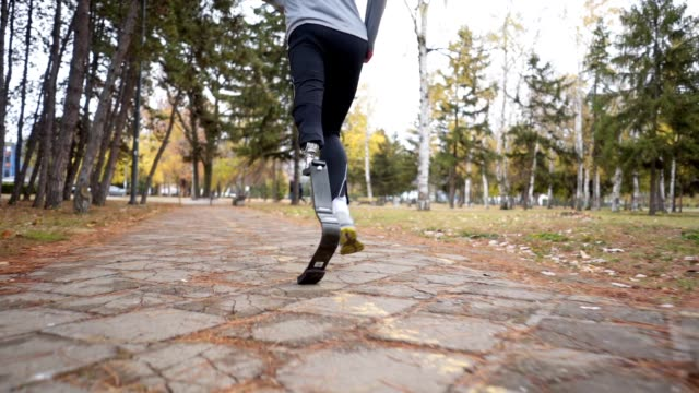 adaptive athlete running outdoors - artificial limb stock videos & royalty-free footage