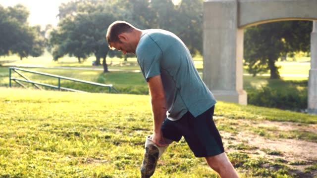 adaptive athlete stretches before run - war veteran stock videos & royalty-free footage