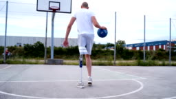 Adaptive athlete taking a shot at basketball court