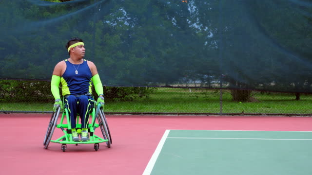ms adaptive athlete warming up for wheelchair tennis match - wheelchair stock videos and b-roll footage