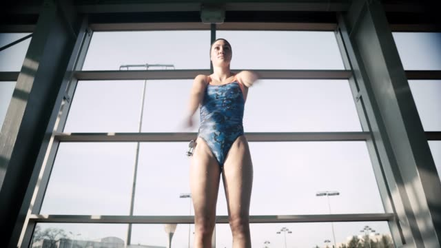 adaptive athlete warming up in the swimming pool - amputee stock videos & royalty-free footage