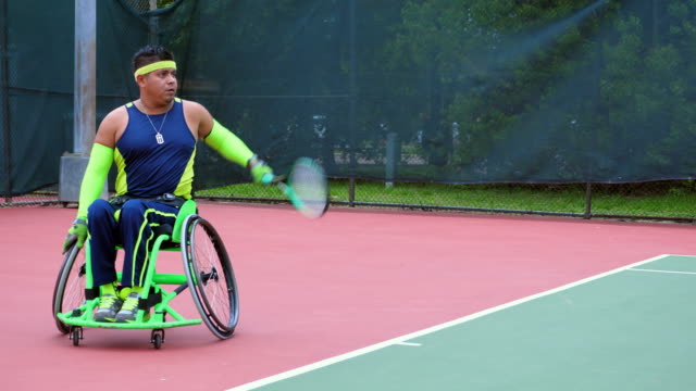 ms adaptive athletes playing wheelchair tennis - wheelchair stock videos & royalty-free footage