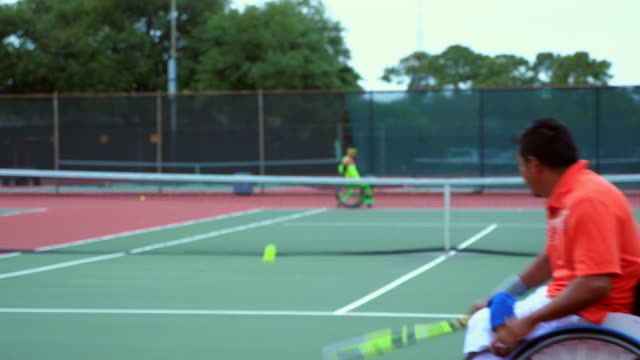 ms adaptive athletes practicing wheelchair tennis together - wheelchair stock videos and b-roll footage