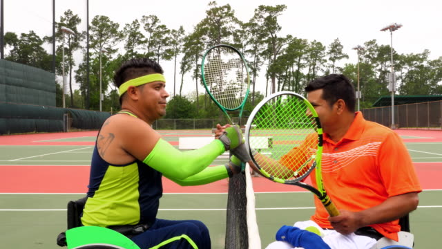 MS Adaptive athletes shaking hands at net after wheelchair tennis match