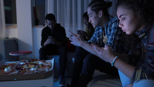 addicted to smart phone - evening meal stock videos & royalty-free footage