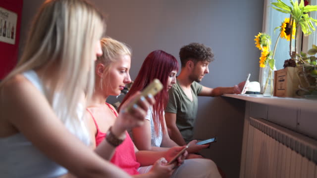 addicted to social media - male with group of females stock videos & royalty-free footage