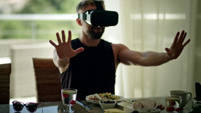 addicted to technology. man having breakfast with vr - oblivious stock videos & royalty-free footage