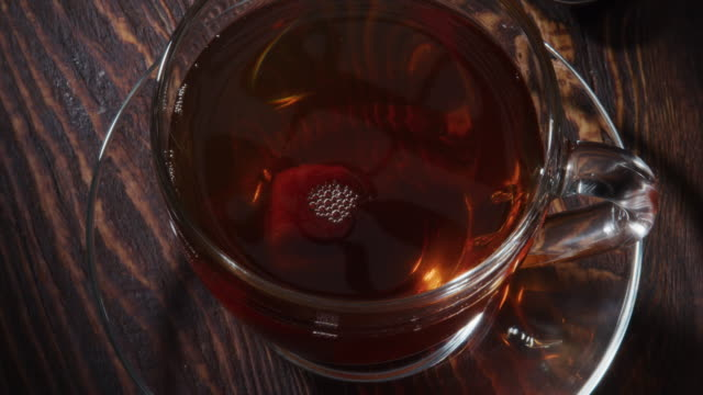 adding a sugar cube into the cup of tea - sugar cube stock videos & royalty-free footage