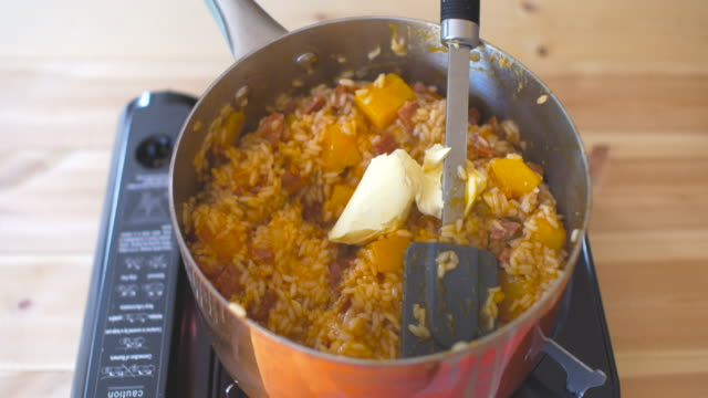 adding butter into butternut squash risotto - butter stock videos & royalty-free footage