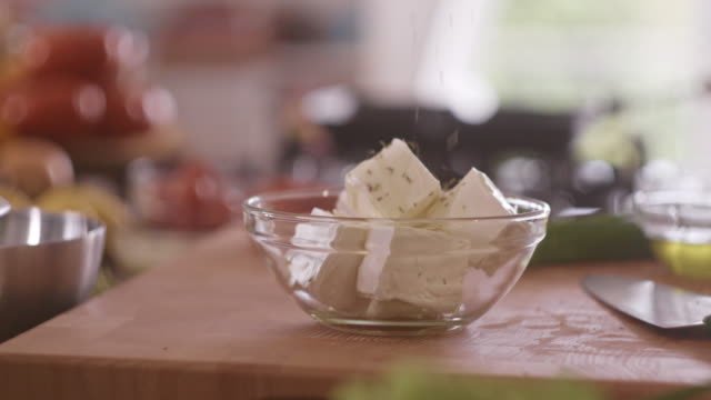 adding condiment into feta cheese salad - sprinkling stock videos and b-roll footage