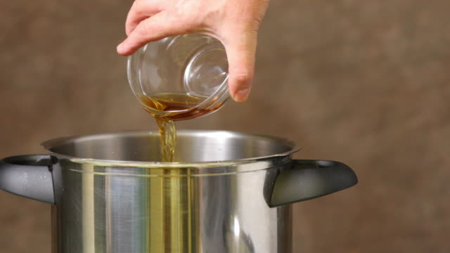 adding dessert ingredients in pressure cooker. - cooking pan stock videos and b-roll footage