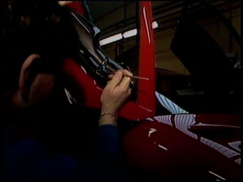 vidéos et rushes de adding details to paint and interior of cars. - voiture particulière