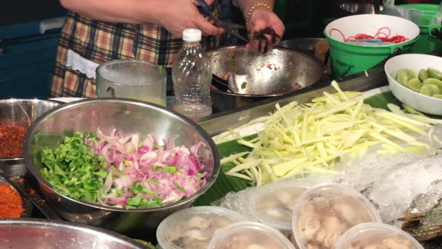 adding fish sauce in thai spicy salad , bangkok , thailand - pickled stock videos and b-roll footage