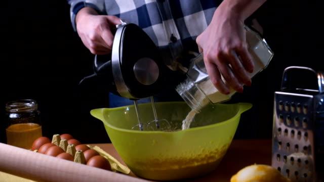 Adding flour in bowl for dough preparation