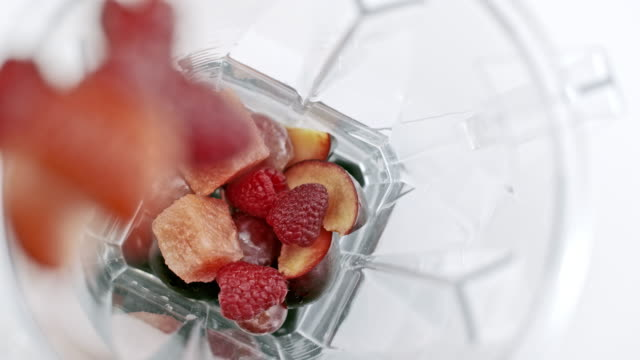 slo mo adding fruit into blender jar - chopped food stock videos and b-roll footage