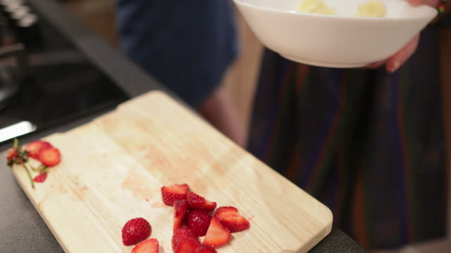 adding fruit to breakfast - fruit bowl stock videos & royalty-free footage