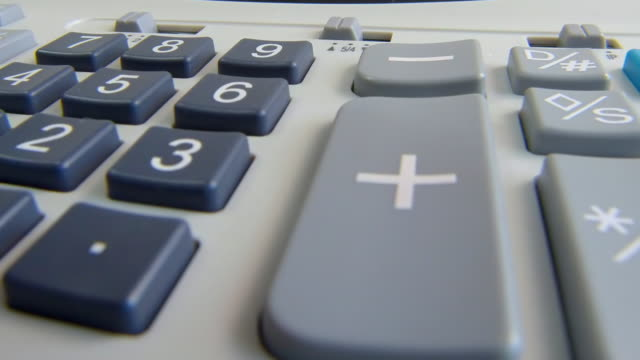 vídeos de stock e filmes b-roll de adding machine - plus key