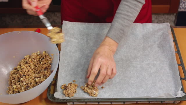 adding oatmeal cookie dough to baking sheet - oatmeal stock videos & royalty-free footage