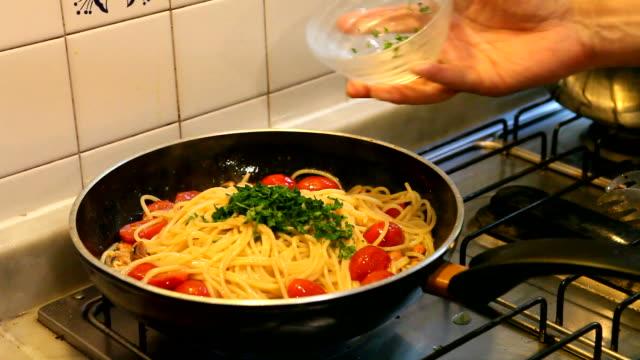Adding Parsley on Spaghetti