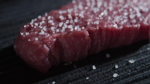 adding salt to a beef steak - adding salt stock videos & royalty-free footage