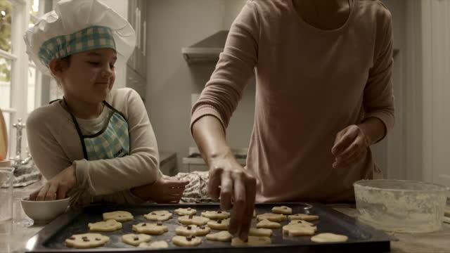 adding some extra treats - baking tray stock videos & royalty-free footage