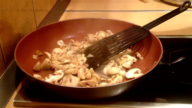 adding white wine to a frying mushrooms - cooking pan stock videos & royalty-free footage