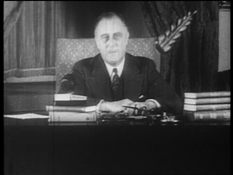 vídeos y material grabado en eventos de stock de fdr addressing camera in fireside chat urging americans to use banks - franklin roosevelt