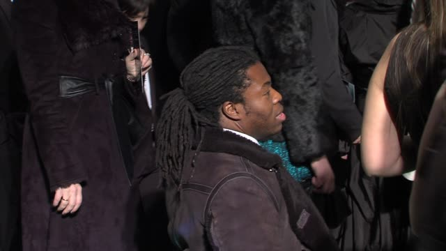 ade adepitan at 'the hobbit' uk premiere and royal film performance at odeon leicester square on december 12, 2012 in london, england. - the hobbit stock videos & royalty-free footage