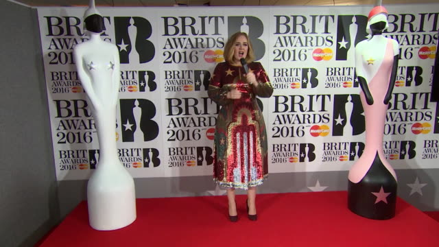 adele on an emotional night, winning 4 awards, being back at the awards, feeling crazy about her upcoming tour at the brit awards at the o2 arena on... - the o2 england stock videos & royalty-free footage
