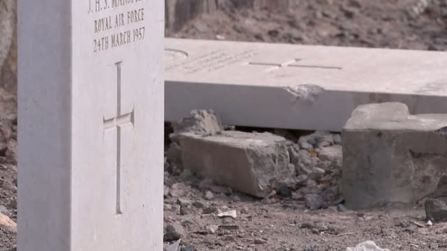 Aden calls for independence as war rages on YEMEN Aden EXT Close shot of inscription on gravestone 'At the going down of the sun' Various shots of...