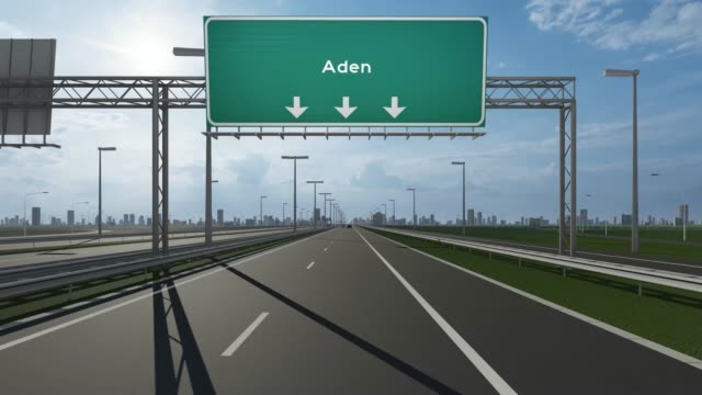 aden city signboard on the highway conceptual stock video indicating the entrance to city - aden stock videos & royalty-free footage
