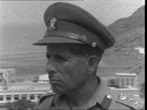 aden near independence; aden: crater: col, mitchell with group of s. arabian army officers; mitchell points s. arabian officer cms mitchell and s.... - aden stock videos & royalty-free footage
