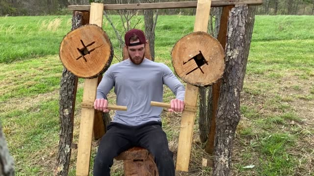 adhering to ohio's stay-at-home order due to the coronavirus outbreak, zachary skidmore bench presses as he lifts weights using his hand-made outdoor... - leg press stock videos & royalty-free footage